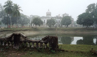 Tajhat Rajbari ('Tajhat Palace', in Rangpur). A grand old mansion, somewhat run-down and no longer used by anyone. It was used a few years ago as a district court. This picture was taken on a cold winter morning. At the time I visited, there did not seem to be any official entry to the inside of the building, but the caretaker on the day gave some companions and myself a quick no-commentary 'round the building' tour. I suppose this kind of building inspection is more meaningful if you are glancingly familiar with the layout of other mansions and palaces. On sunnier days, the surrounding grounds are a popular picnic spot. The surrounding grounds are free for public use.